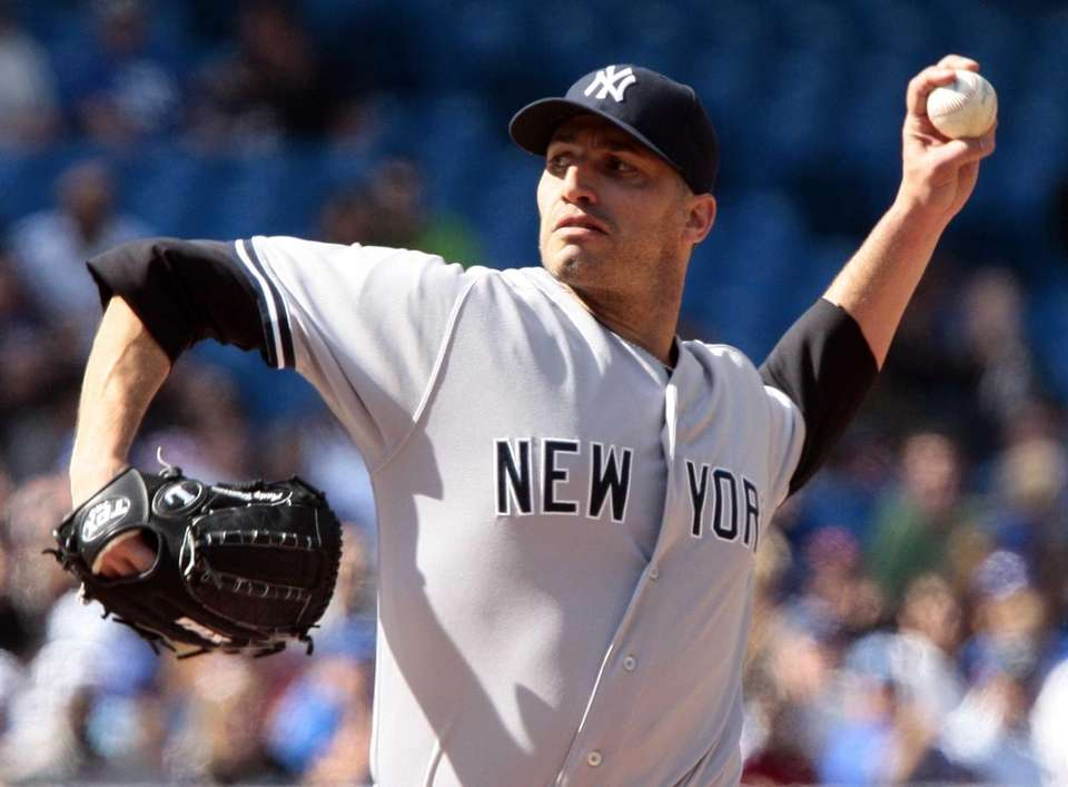 Andy Pettitte throws a pitch in a game