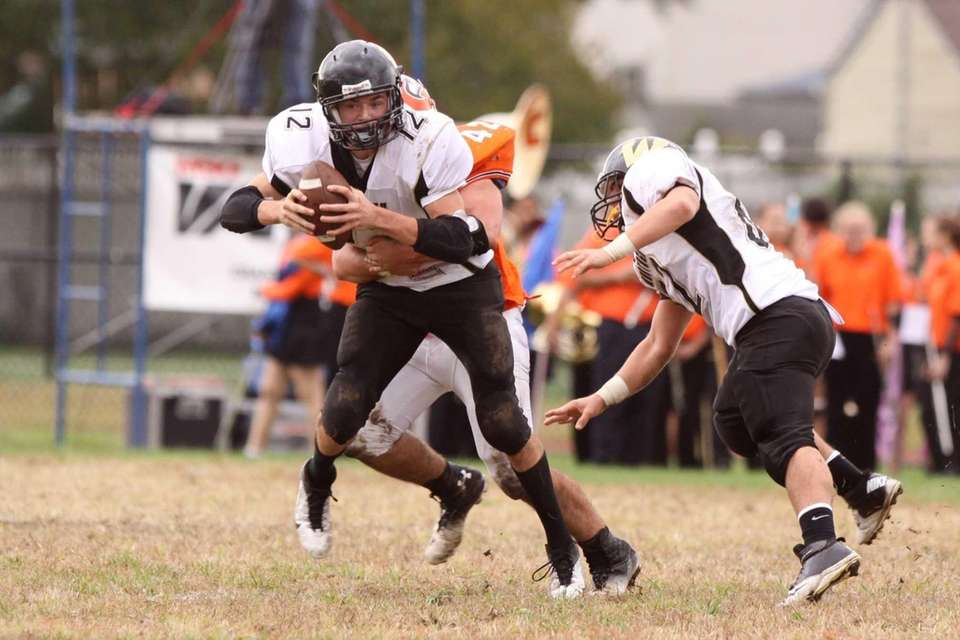 Wantagh's Gerard Roche is sacked by Carey's Thomas