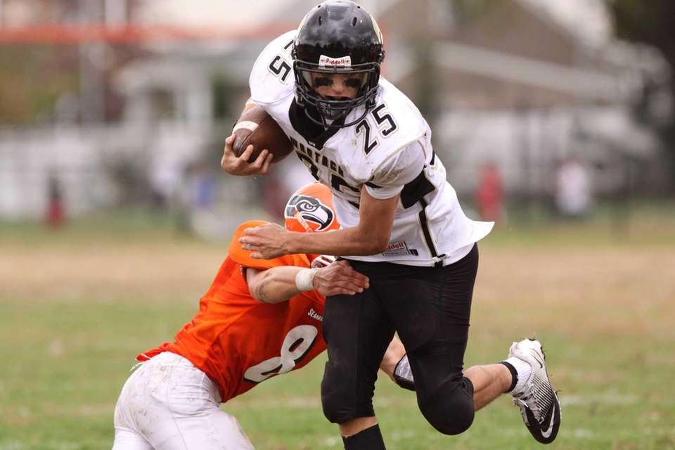 Wantagh's Brandon Watson, right, eludes the tackle of