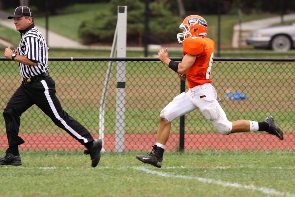 Carey's Michael De Leo runs back a kickoff