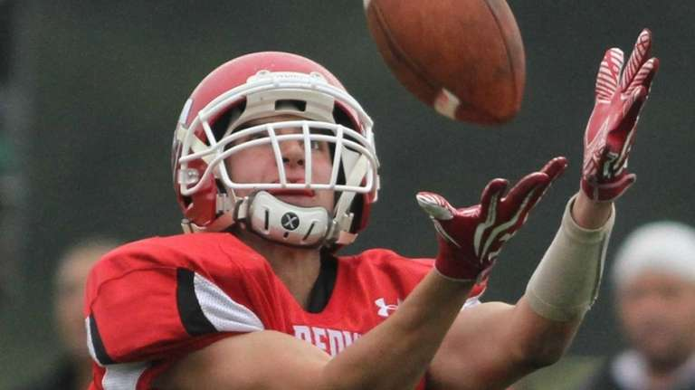 East Islip's Mike Lee catches a pass all