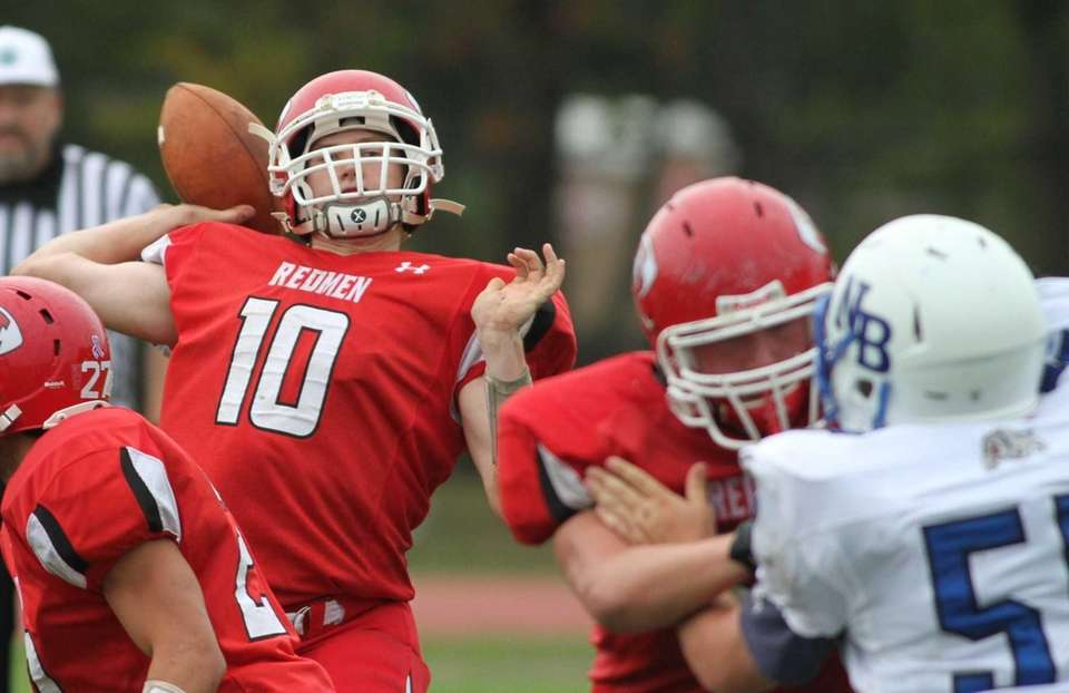 East Islip's quarterback Casey Nolan, left, passes over