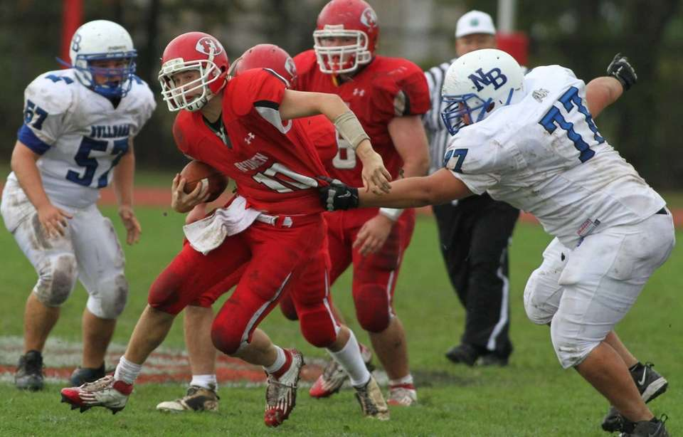 East Islip's quarterback Casey Nolan breaks free of