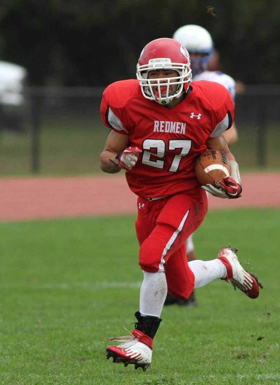 East Islip's Andre Deegan runs past North Babylon's