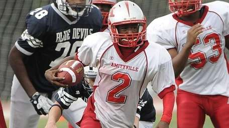 Amityville quarterback Sean Walters drives the ball against