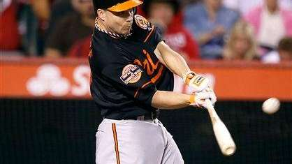 Baltimore Orioles' Steve Pearce hits a three-run home