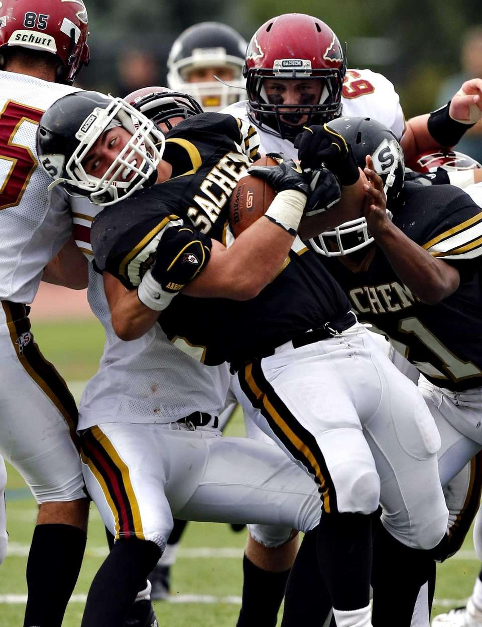 Sachem North's Tyler Andreassi twists away from tacklers