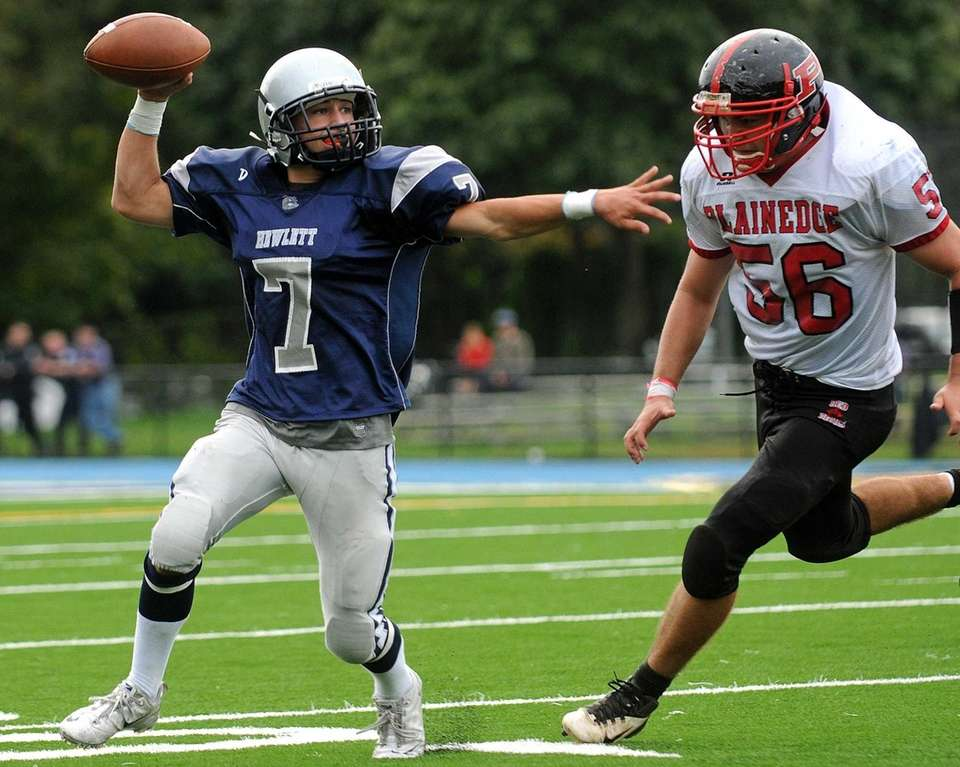 Hewlett quarterback Zach Richman looks to get off