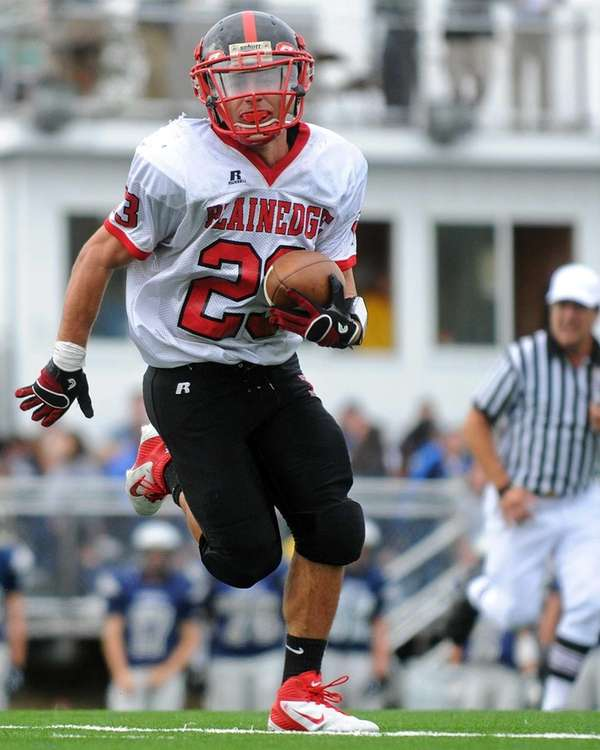 Plainedge running back Gianfranco Soriente rushes for a