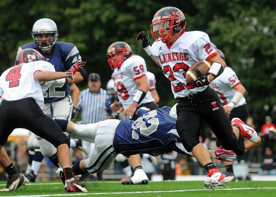 Plainedge running back Gianfranco Soriente, right, evades a
