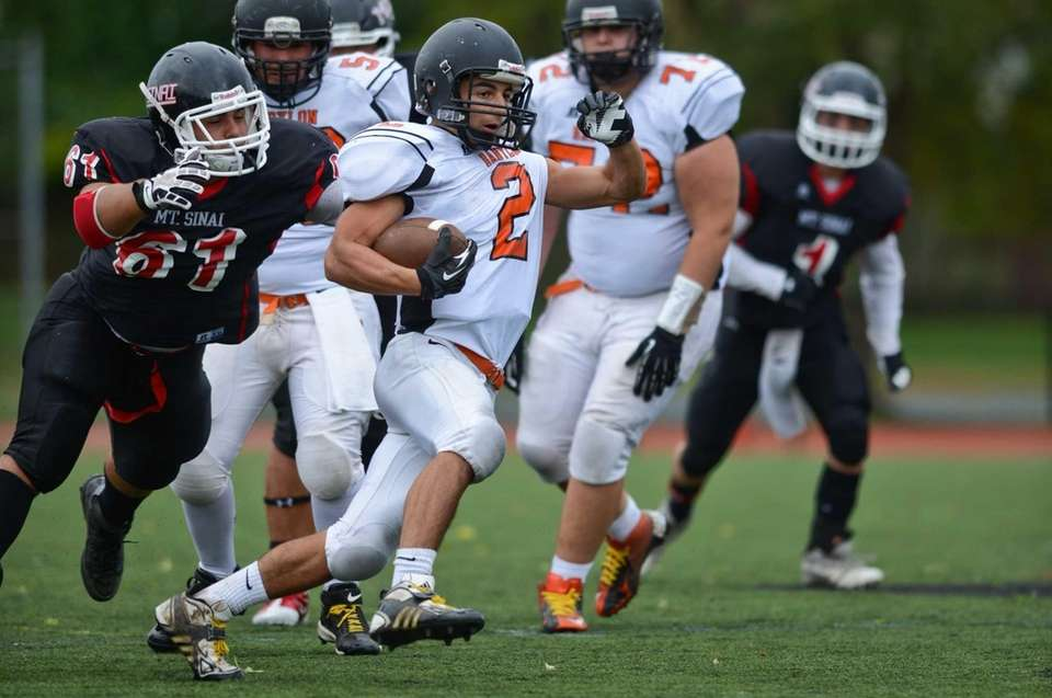 Babylon's Luke Zappia runs the ball from Mt.