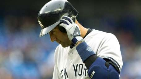 Derek Jeter reacts after popping out to second