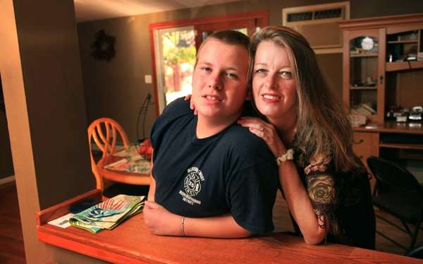 Carol Scanlan and her son, Bill, 14, in