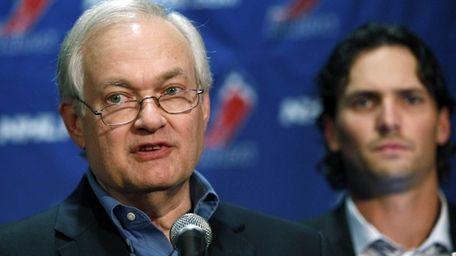 NHL Players' Association executive director Donald Fehr, center,