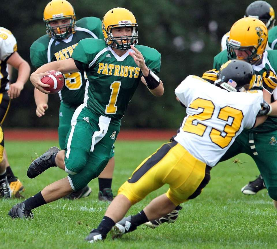 Ward Melville quarterback Jake Biro scrambles out of