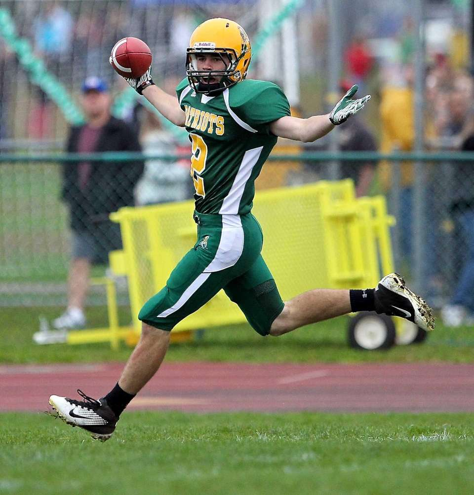 Ward Melville receiver Brendon Dooley celebrates his first