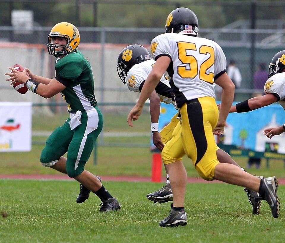 Ward Melville quarterback Jake Biro looks for an