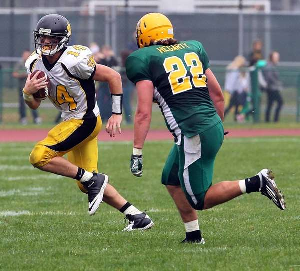 Commack quarterback Ryan Heizman goes to the outside