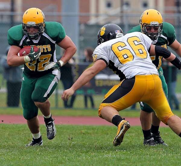 Ward Melville's Brendan Hegarty blows through the hole