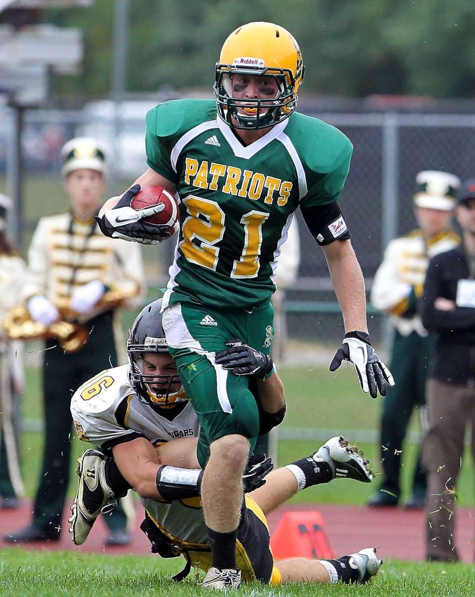Ward Melville receiver Andrew Tirelli tries to shake