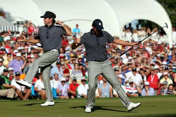 Webb Simpson and Bubba Watson celebrate Simpson's birdie