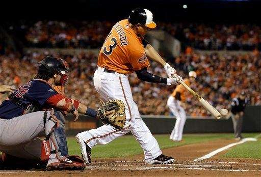 The Baltimore Orioles' Manny Machado singles in the