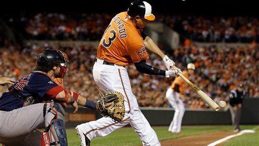The Baltimore Orioles' Manny Machado singles in the
