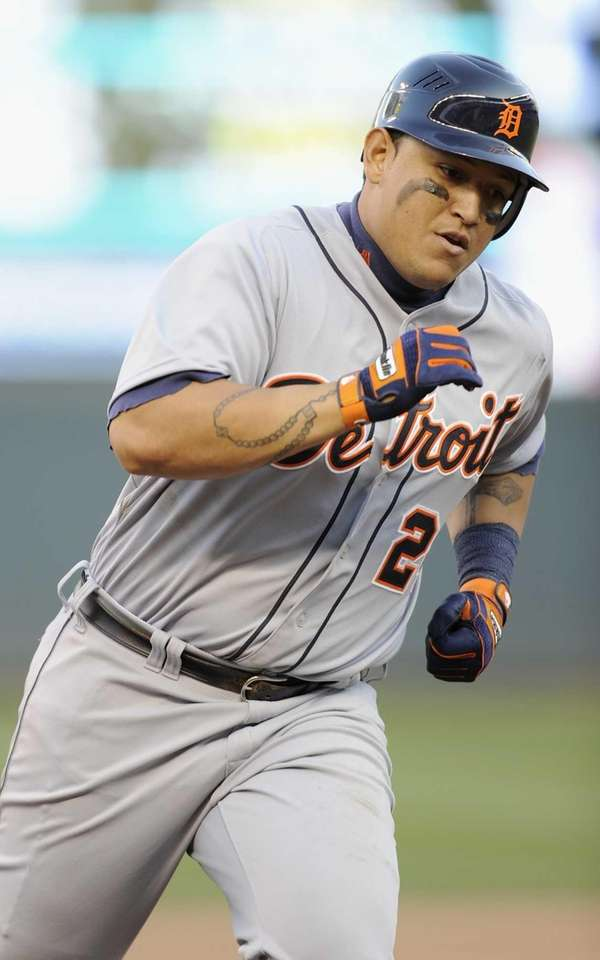 The Detroit Tigers' Miguel Cabrera rounds the bases