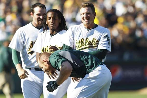 The Oakland Athletics' Brandon Moss is congratulated by