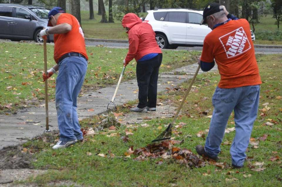 Volunteers from The Home Depot work through the