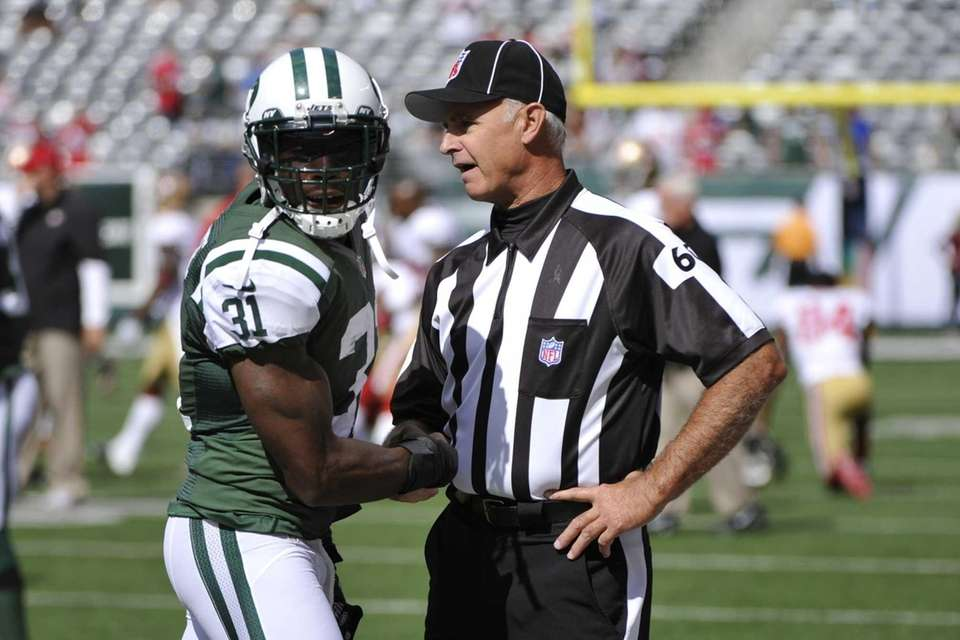 Jets cornerback Antonio Cromartie talks with field judge