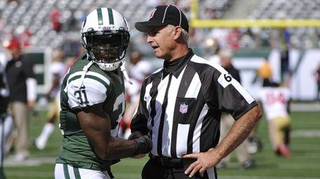 Jets cornerback Antonio Cromartie talks with field judge