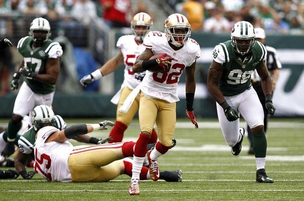 San Francisco 49ers wide receiver Mario Manningham runs