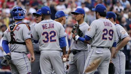 The New York Mets surround starting pitcher Jenrry