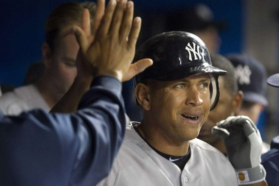 Alex Rodriguez celebrates after scoring on a wild
