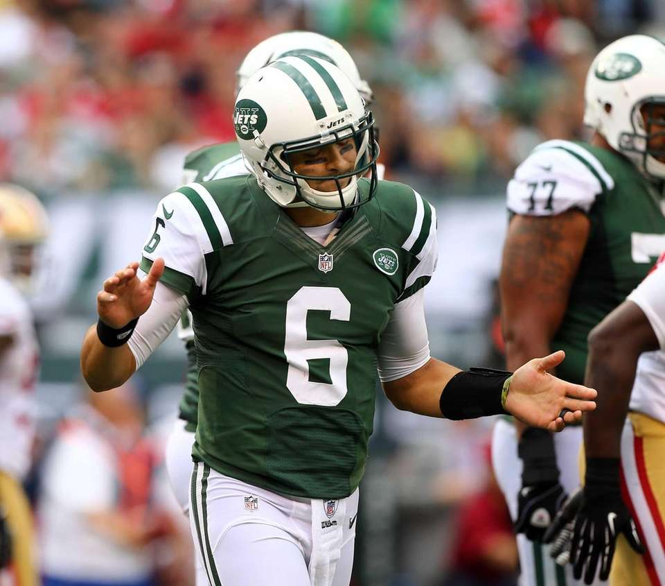 Mark Sanchez reacts as he walks to the