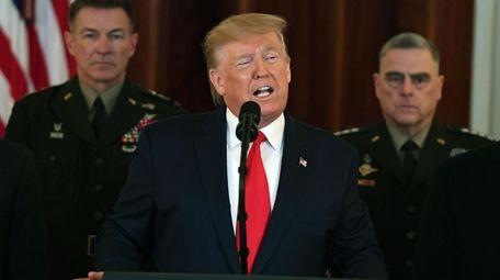 President Donald Trump speaks in the Grand Foyer