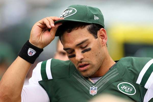 Mark Sanchez looks on from the bench during
