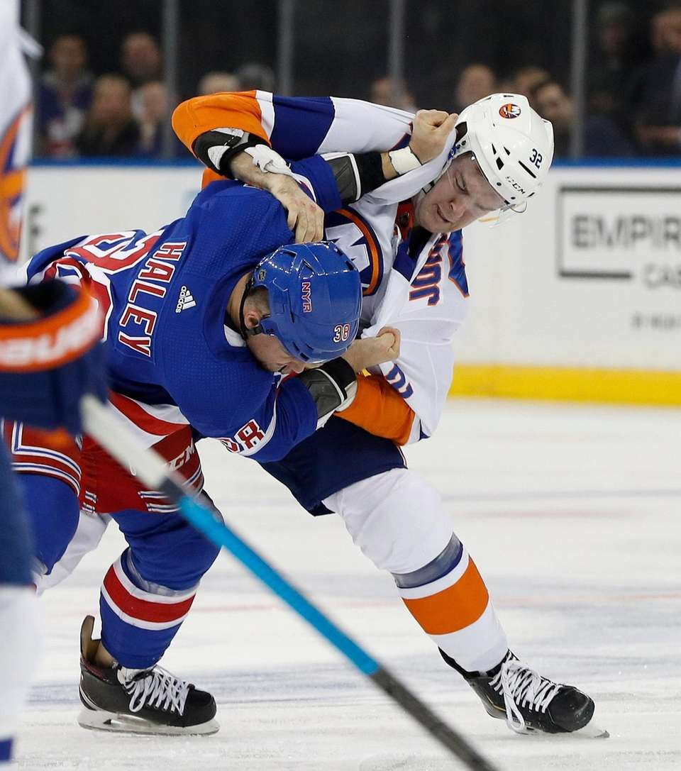 Ross Johnston of the Islanders fights Micheal Haley
