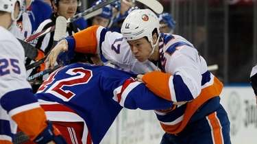 Matt Martin of the Islanders fights Brendan Smith
