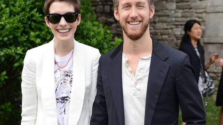 Actors Anne Hathaway and Adam Shulman, who got