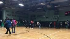 Spectators leave the Wyandanch High School gymnasium after