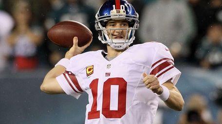 Quarterback Eli Manning of the Giants drops back