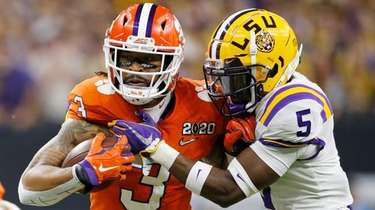 Clemson wide receiver Amari Rodgers, left, is tackled