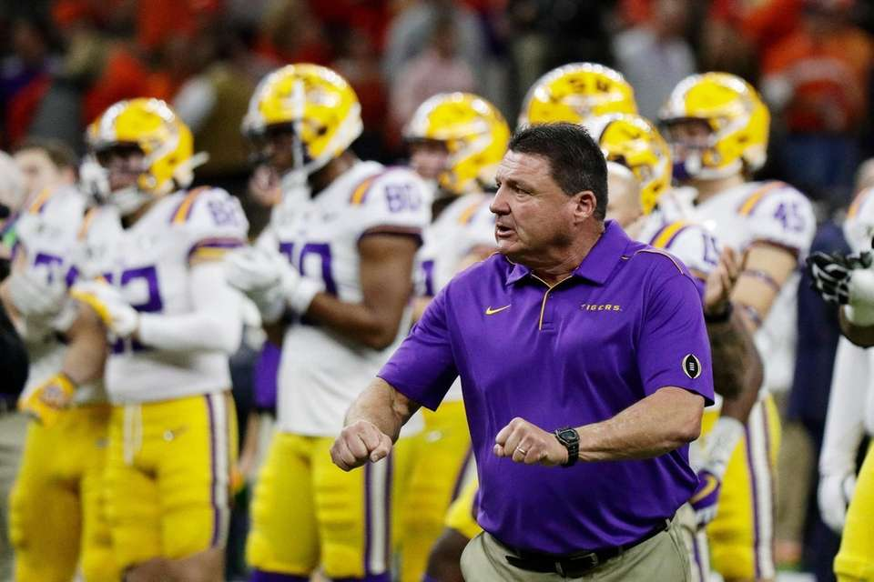LSU head coach Ed Orgeron watches during warm