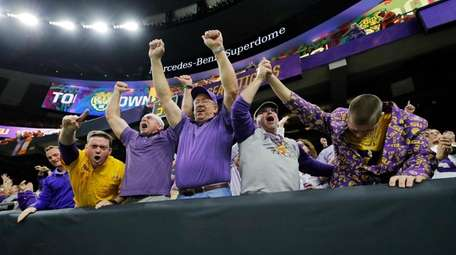 Fans celebrates after LSU wide receiver Ja'Marr Chase