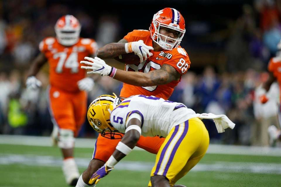 Clemson tight end Braden Galloway is tackled by