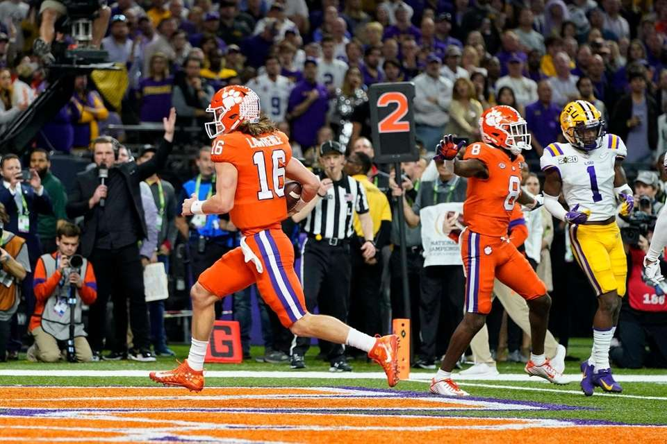Clemson quarterback Trevor Lawrence scores against LSU during