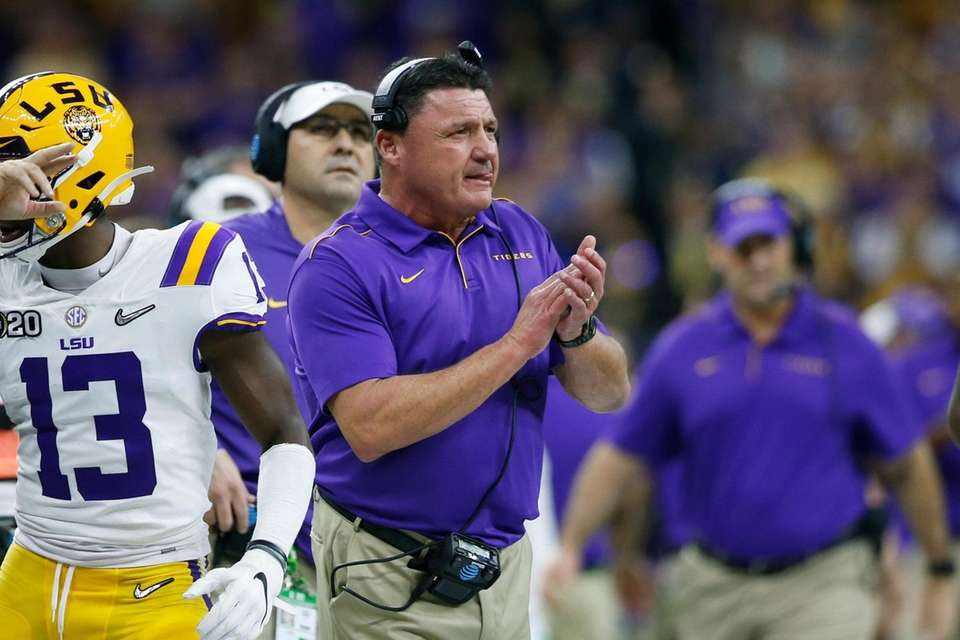 LSU head coach Ed Orgeron watches during the
