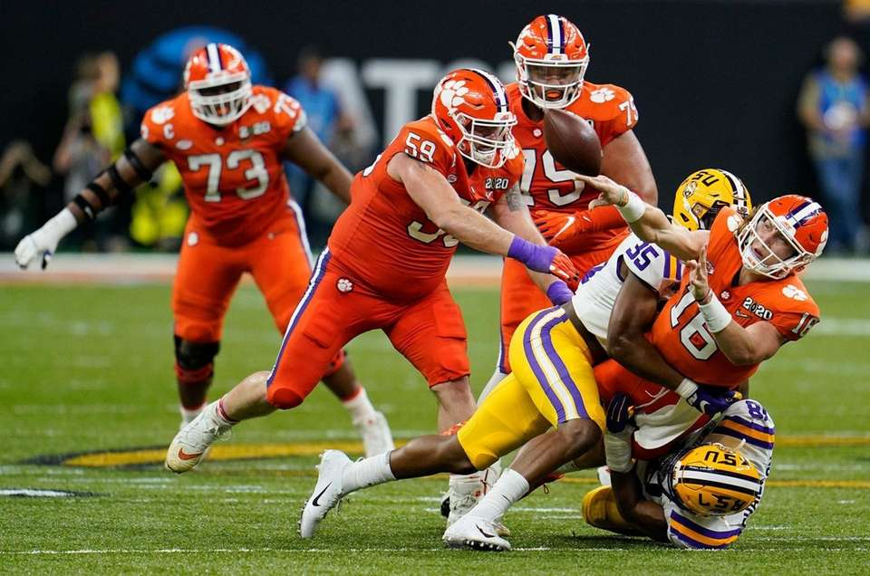 Clemson quarterback Trevor Lawrence passes under pressure against